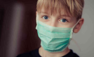 Boy in surgical mask